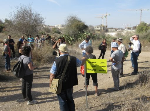 Erik Ader, far right, joins a signposting tour of the ruins of the Palestinian village of Bayt Nattif (copyright: Jonathan Cook)