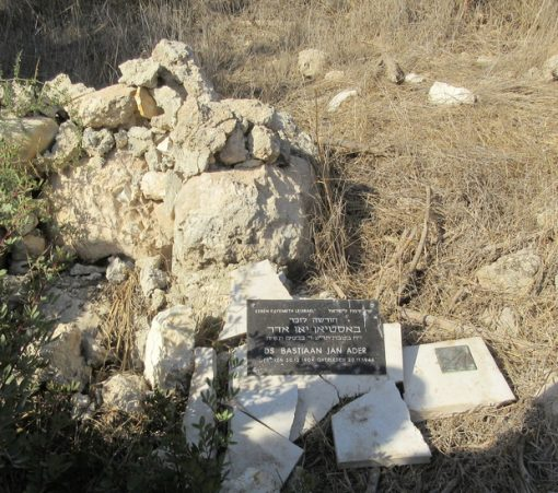 The Jewish National Fund's plaque dedicating the forest over the ruins of Bayt Nattif to the Rev Bastiaan Jan Ader was vandalised after it was made public that his son, Erik Ader, was due to issue an apology to the village's refugees (copyright: Jonathan Cook)